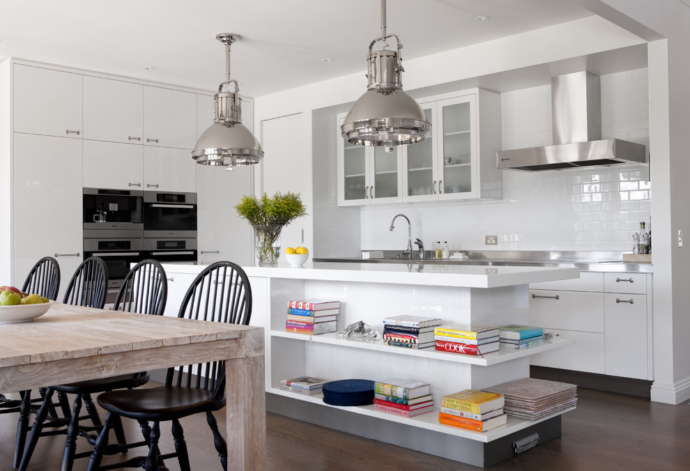 Inspiration for a timeless kitchen remodel in Melbourne with glass-front cabinets, white cabinets, white backsplash, subway tile backsplash and stainless steel appliances