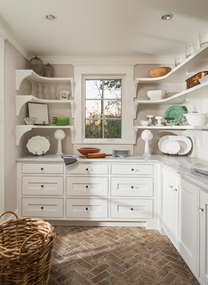 Mountain style l-shaped brick floor kitchen pantry photo in Other with white cabinets and gray countertops