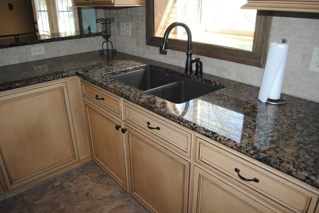 Baltic Brown Granite with Tile Backsplash. Maple Cabinets ...