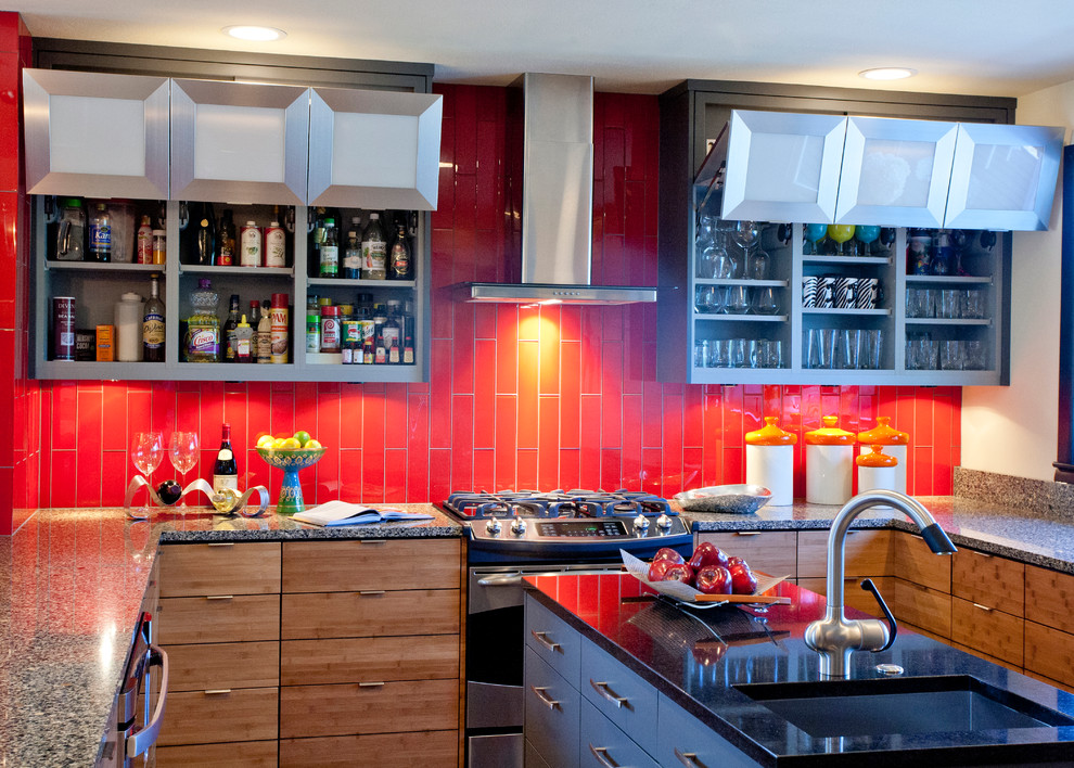 Example of a trendy u-shaped eat-in kitchen design in Kansas City with stainless steel appliances, an undermount sink, flat-panel cabinets, medium tone wood cabinets, red backsplash, quartz countertops and glass tile backsplash