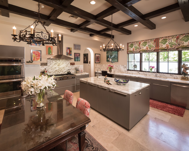 Large tuscan l-shaped enclosed kitchen photo in Houston with an undermount sink, flat-panel cabinets, gray cabinets, white backsplash, stainless steel appliances and an island