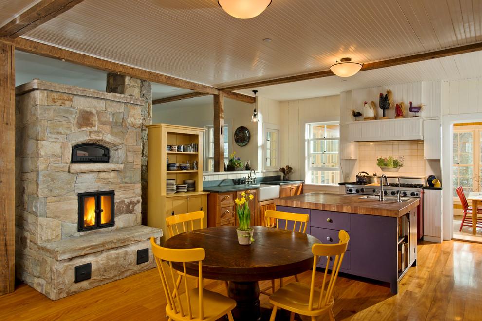 Inspiration for a cottage l-shaped medium tone wood floor open concept kitchen remodel in New York with a farmhouse sink, shaker cabinets, medium tone wood cabinets, beige backsplash and ceramic backsplash