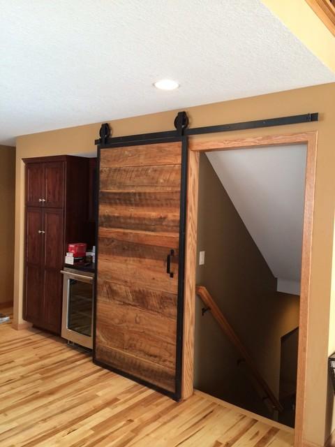 Barn wood sliding door farmhouse kitchen atlanta for Sliding door for kitchen entrance
