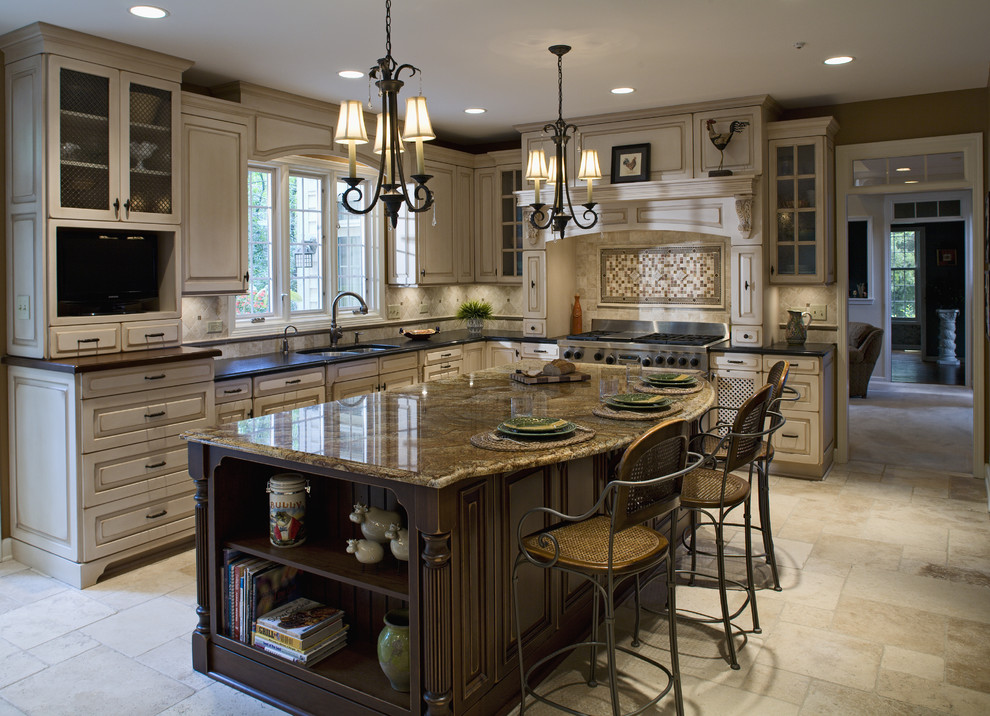 Example of a classic kitchen design in Chicago with glass-front cabinets and brown countertops