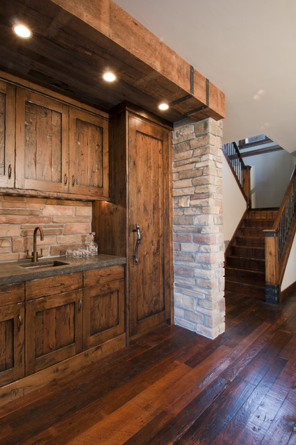 Basement rustic kitchen minneapolis by carl m for Basement kitchen cabinets