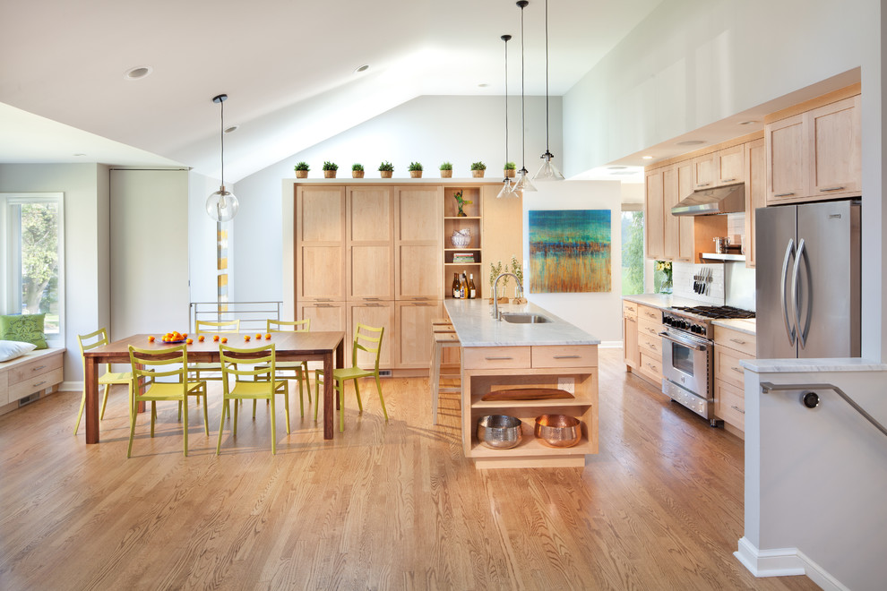 Example of a trendy eat-in kitchen design in DC Metro with an undermount sink, shaker cabinets, light wood cabinets and stainless steel appliances