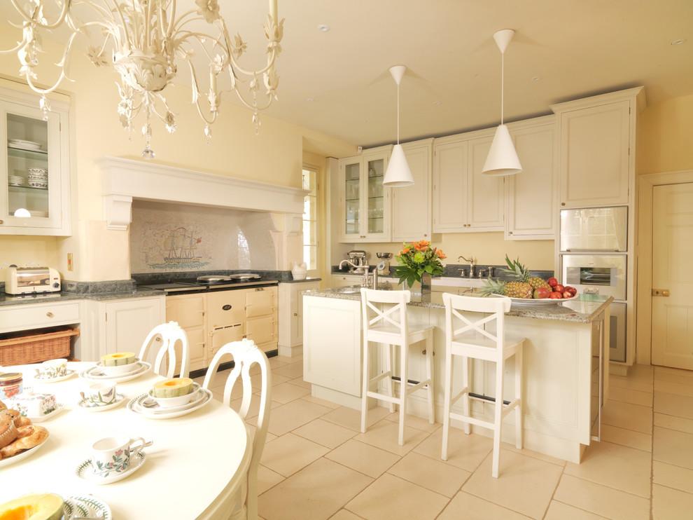 Kitchen - farmhouse kitchen idea in London with stainless steel appliances