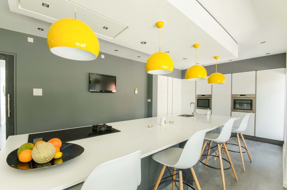 Example of a trendy kitchen design in Other with flat-panel cabinets, white cabinets and an island