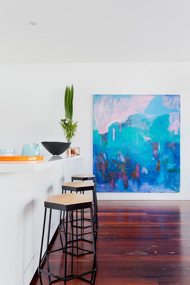 Trendy dark wood floor kitchen photo in Melbourne with a peninsula