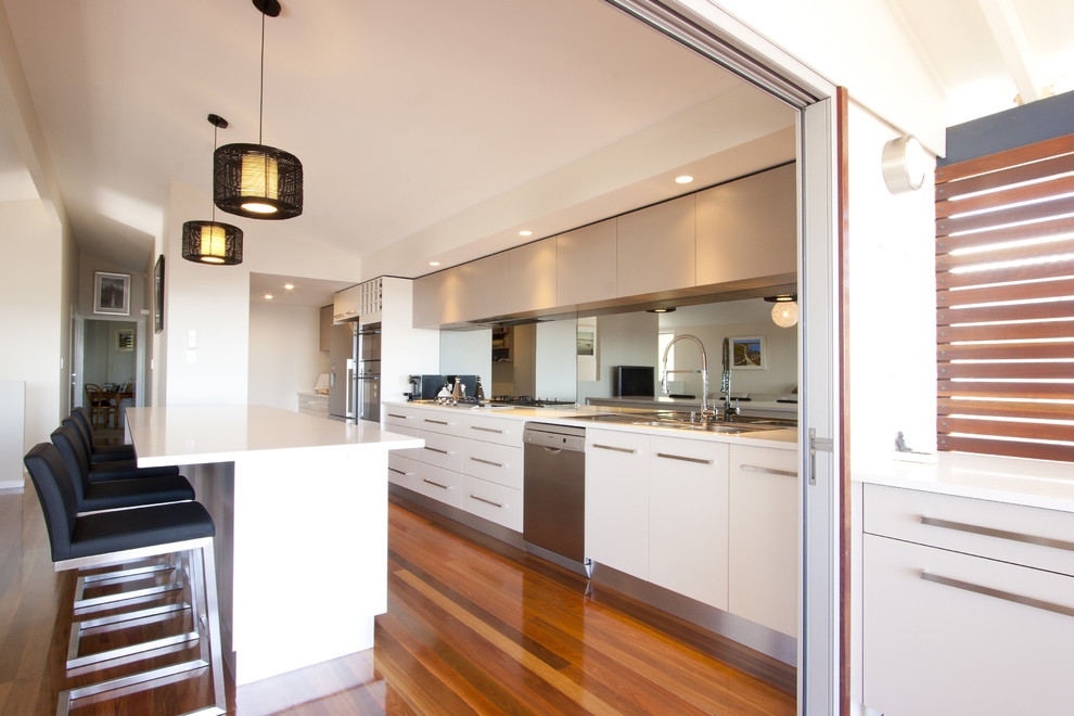 Trendy single-wall kitchen photo in Brisbane with stainless steel appliances
