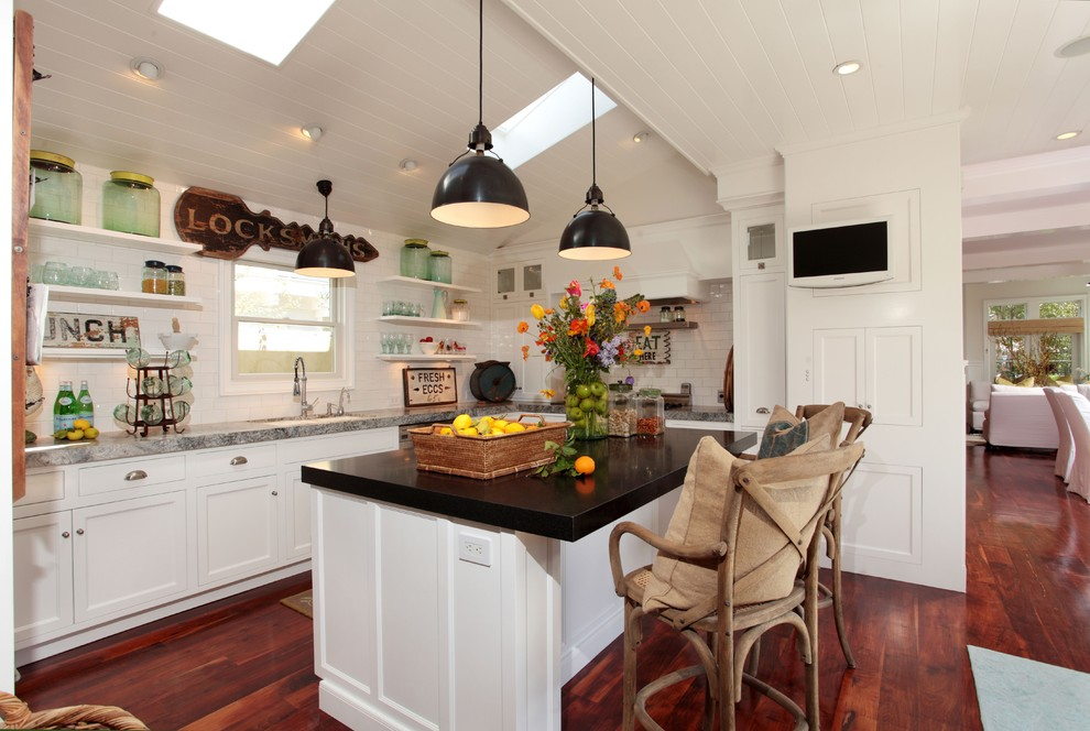 Inspiration for an eclectic open concept kitchen remodel in Los Angeles with open cabinets, white cabinets, white backsplash and subway tile backsplash
