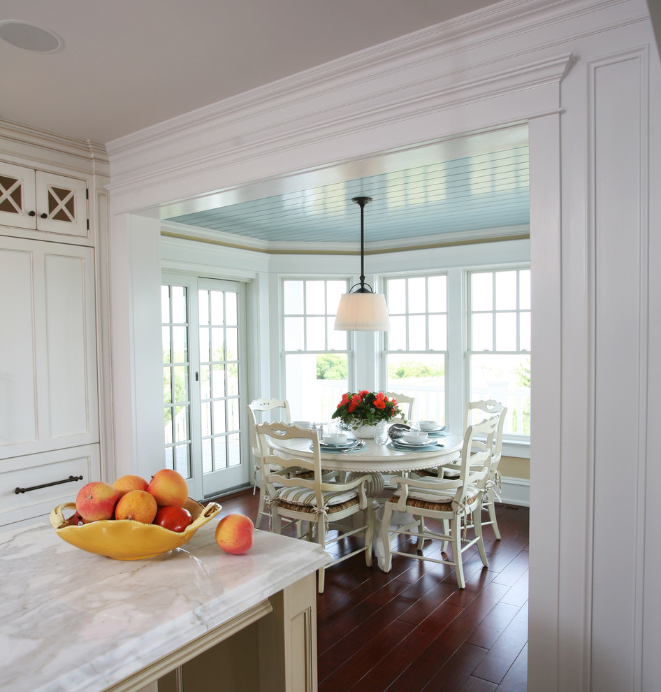 Example of a beach style eat-in kitchen design in Philadelphia with recessed-panel cabinets and white cabinets