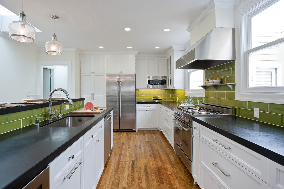 Kitchen - coastal kitchen idea in San Francisco with recessed-panel cabinets, stainless steel appliances, an undermount sink, white cabinets, green backsplash and subway tile backsplash