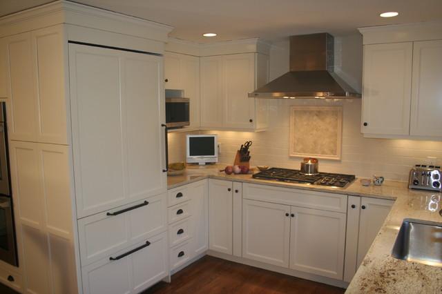 Beach white kitchen with cherry amber island traditional-kitchen