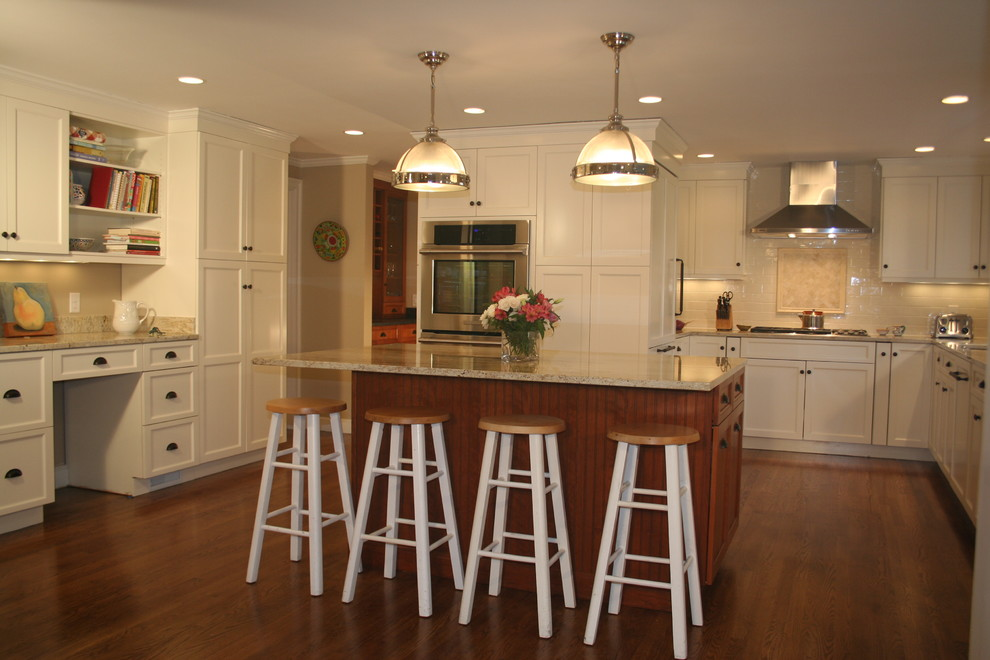 Beach white kitchen with cherry amber island