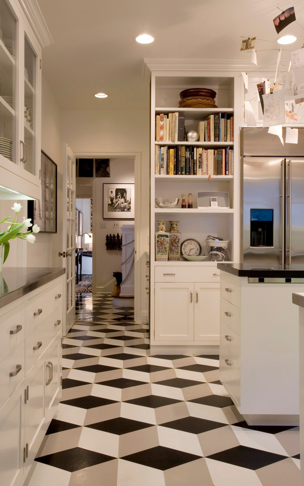 Minimalist multicolored floor kitchen photo in Los Angeles with shaker cabinets, white cabinets and stainless steel appliances