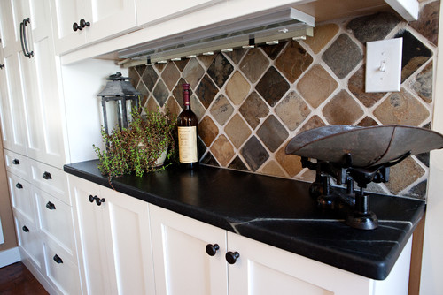 Black Soapstone counters with colorful subway tile backsplash ... on grey marble, granite countertops, grey stone countertops, quartz countertops, white countertops, grey quartz, grey corian, grey black countertops, grey bathroom countertops, grey crushed granite, lowe's bathroom cabinets and countertops, grey limestone countertops, grey wood countertops, grey samples, grey obsidian countertops, gray marble countertops, grey leather granite, home depot formica countertops, slate countertops, grey ceramic countertops,