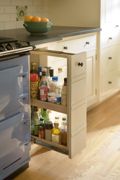 Example of a classic light wood floor kitchen design in Boston