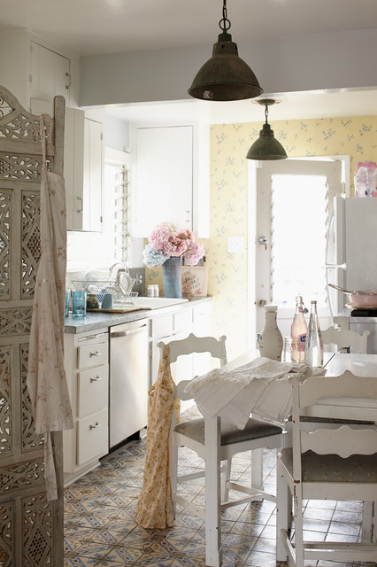 Inspiration for a small shabby-chic style galley ceramic floor enclosed kitchen remodel in Los Angeles with white cabinets, no island, a drop-in sink and flat-panel cabinets
