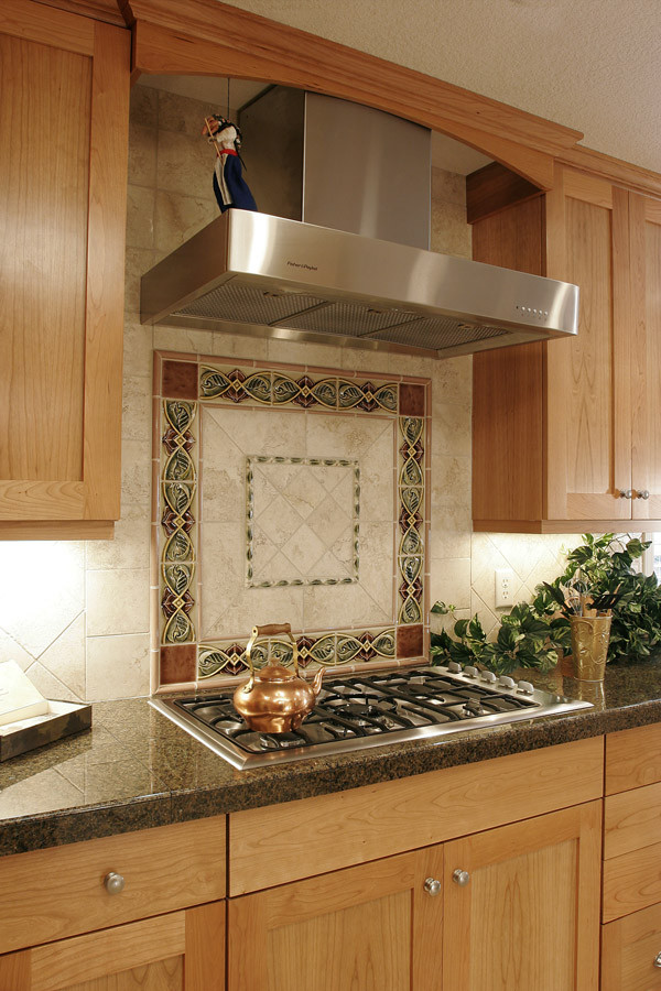 Inspiration for a mid-sized timeless galley open concept kitchen remodel in Portland with shaker cabinets, light wood cabinets, granite countertops, multicolored backsplash, ceramic backsplash and stainless steel appliances