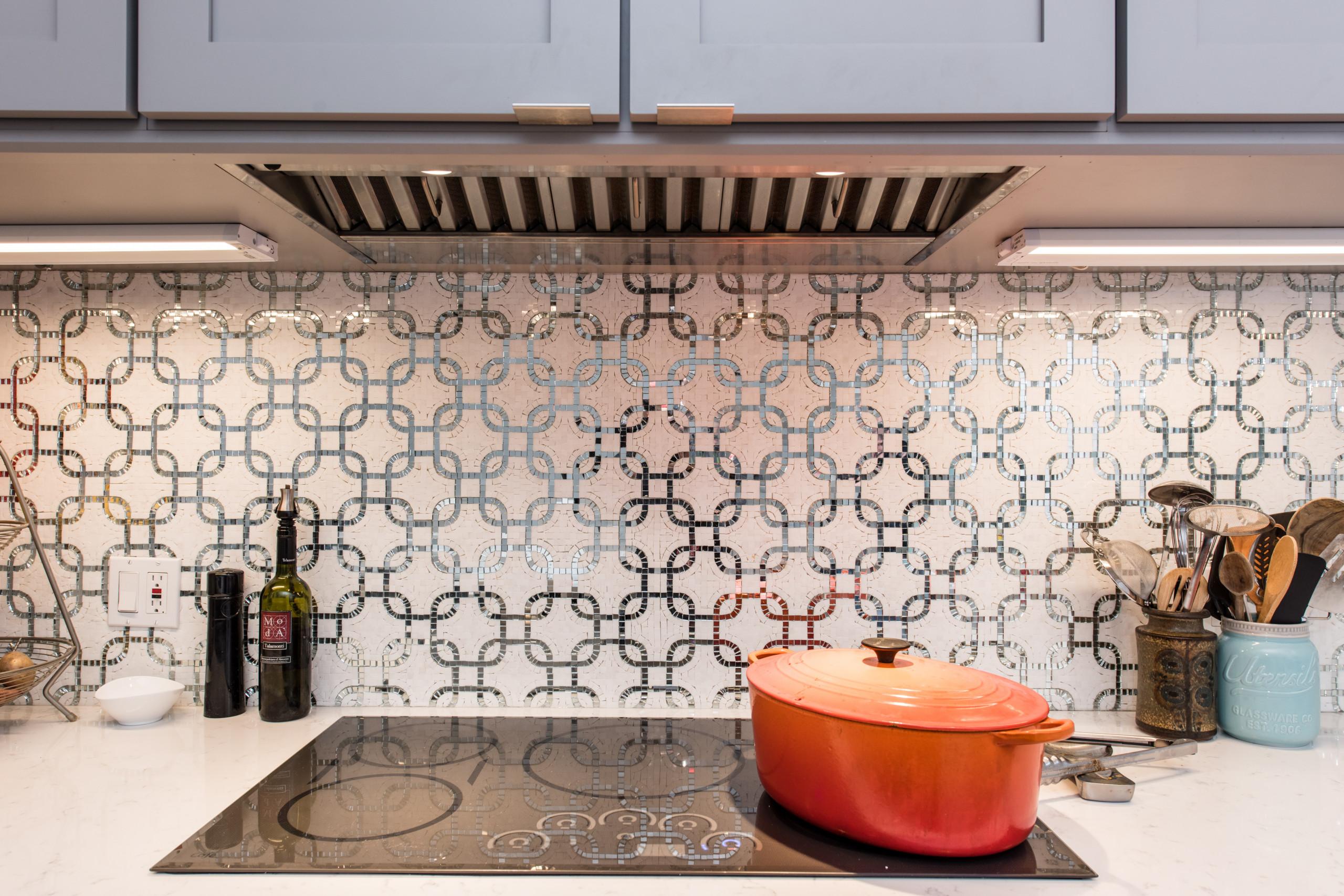 Beautiful mosaic marble and metal patterned backsplash