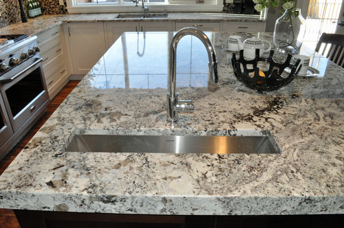 alaska white granite with maple cabinets how much does cost slab price