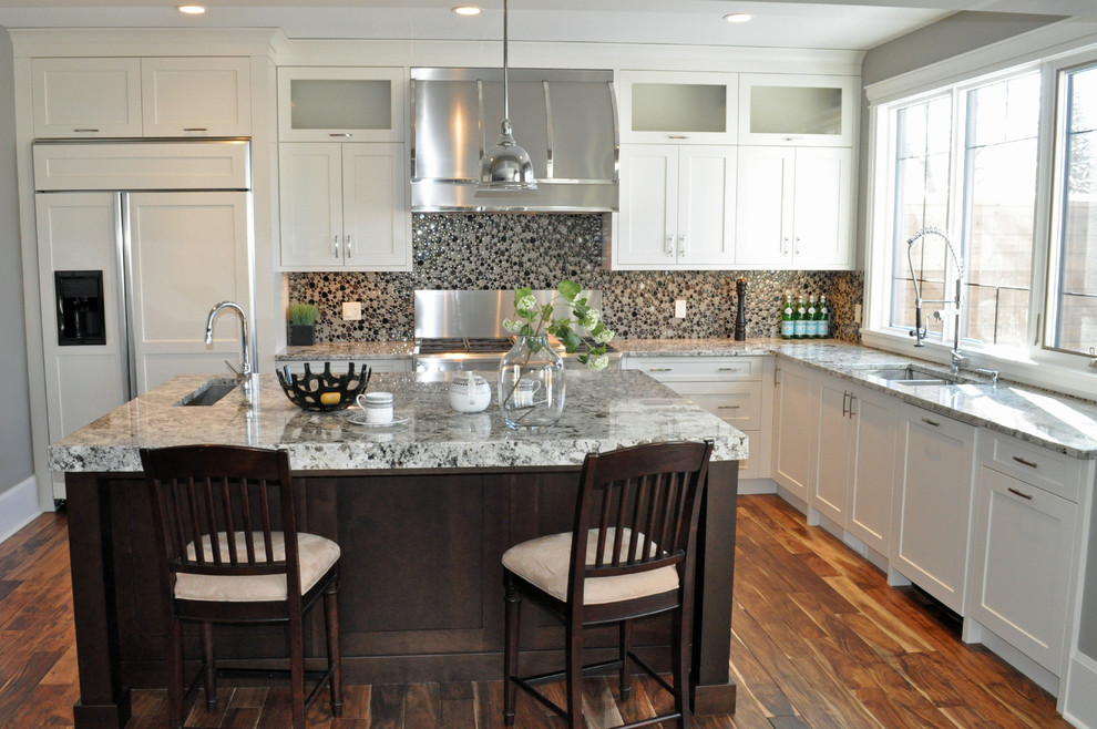 Kitchen - traditional kitchen idea in Calgary with paneled appliances