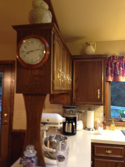 Before: A line of supported wall cabinets blocked visibility from the kitchen to traditional-kitchen