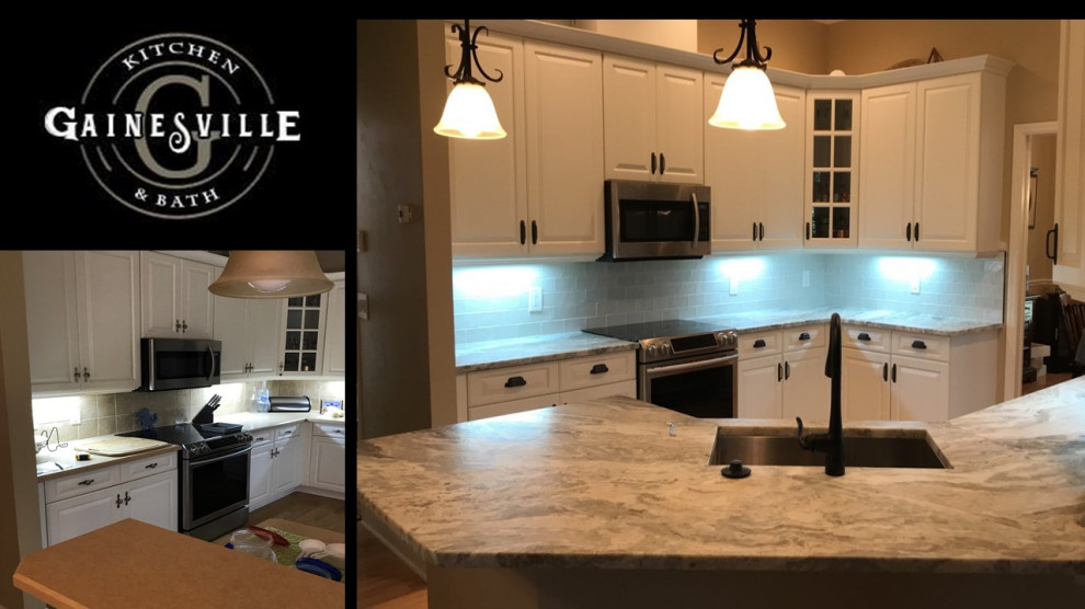 Example of a large u-shaped eat-in kitchen design in Jacksonville with an undermount sink, shaker cabinets, white cabinets, quartzite countertops, white backsplash, glass tile backsplash, black appliances, an island and gray countertops