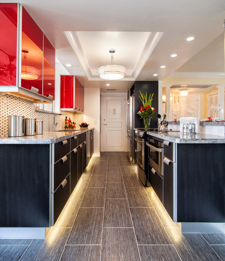 Kitchen - mid-sized contemporary galley porcelain tile kitchen idea in Miami with an undermount sink, granite countertops, white backsplash, glass tile backsplash, stainless steel appliances, red cabinets, no island and flat-panel cabinets