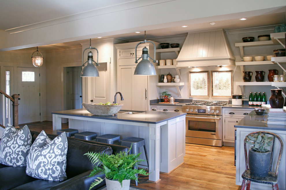 Open concept kitchen - traditional l-shaped open concept kitchen idea in Atlanta with a double-bowl sink, recessed-panel cabinets, white cabinets and stainless steel appliances