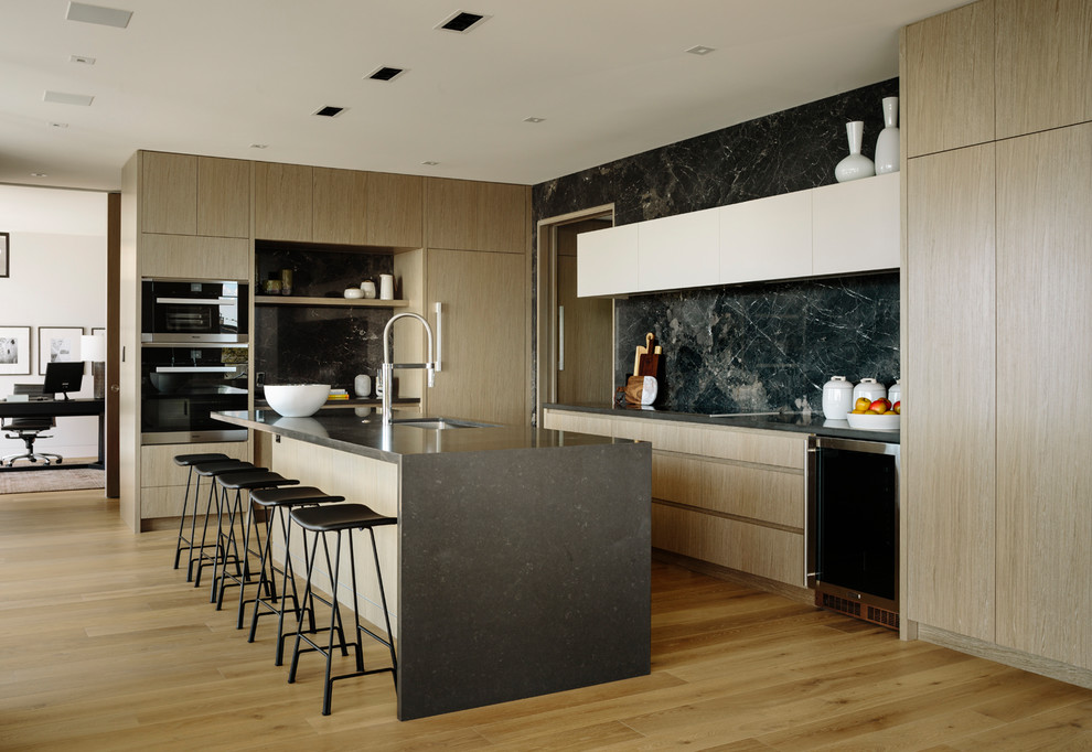Inspiration for a large contemporary l-shaped medium tone wood floor and brown floor eat-in kitchen remodel in Vancouver with an undermount sink, flat-panel cabinets, medium tone wood cabinets, quartz countertops, porcelain backsplash, stainless steel appliances, an island, gray countertops and black backsplash