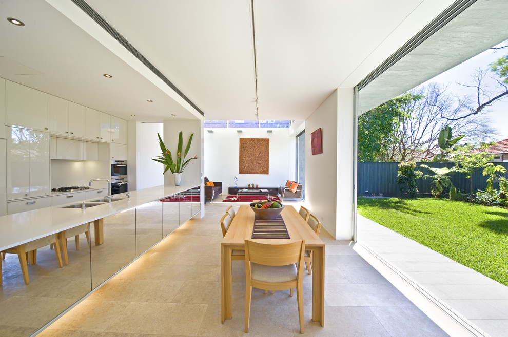 Eat-in kitchen - contemporary eat-in kitchen idea in Sydney with flat-panel cabinets and white cabinets