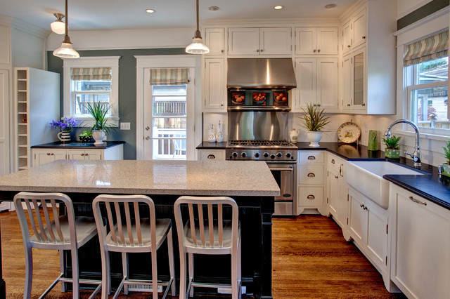 Example Of An Arts And Crafts Kitchen Design In Seattle With A Farmhouse Sink Granite