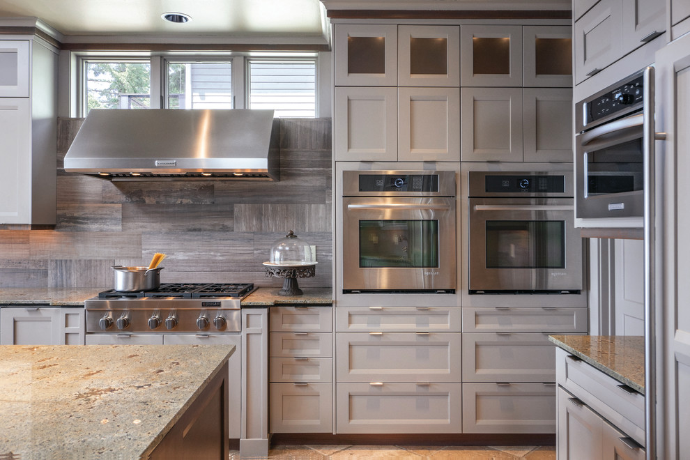 Large transitional kitchen photo in Seattle with recessed-panel cabinets, gray cabinets, granite countertops, stainless steel appliances and an island
