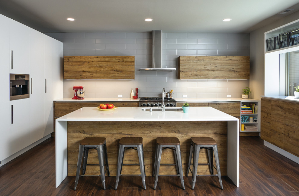 Kitchen - mid-sized contemporary dark wood floor kitchen idea in Seattle with an undermount sink, flat-panel cabinets, medium tone wood cabinets, quartz countertops, gray backsplash, glass sheet backsplash and an island