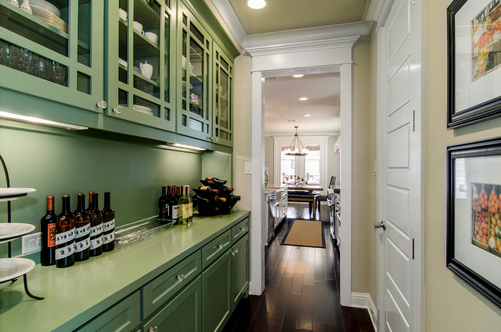Elegant kitchen photo in Dallas with glass-front cabinets, green cabinets, green backsplash and green countertops