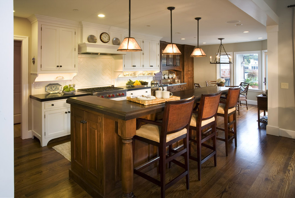 Elegant kitchen photo in San Francisco with white backsplash and an island