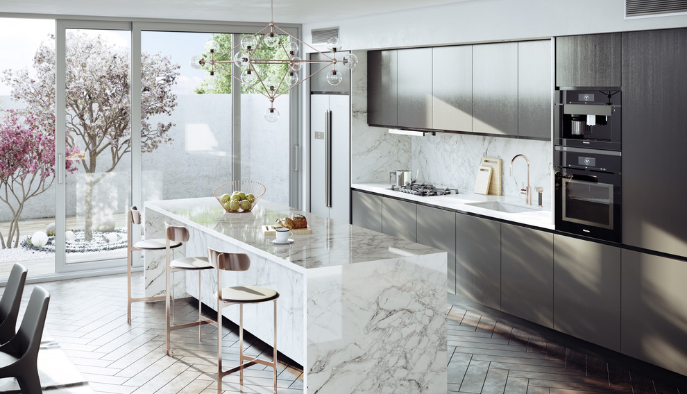 Example of a trendy single-wall brown floor eat-in kitchen design in Other with an undermount sink, flat-panel cabinets, gray cabinets, gray backsplash, an island and white countertops