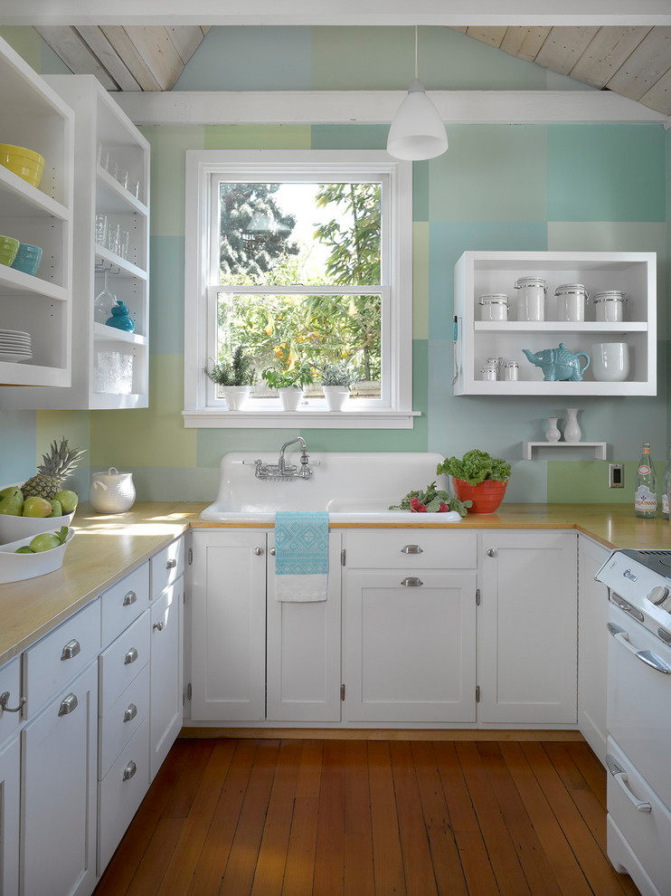 Eclectic u-shaped medium tone wood floor and orange floor kitchen photo in San Francisco with a drop-in sink, open cabinets, white cabinets, window backsplash and white appliances