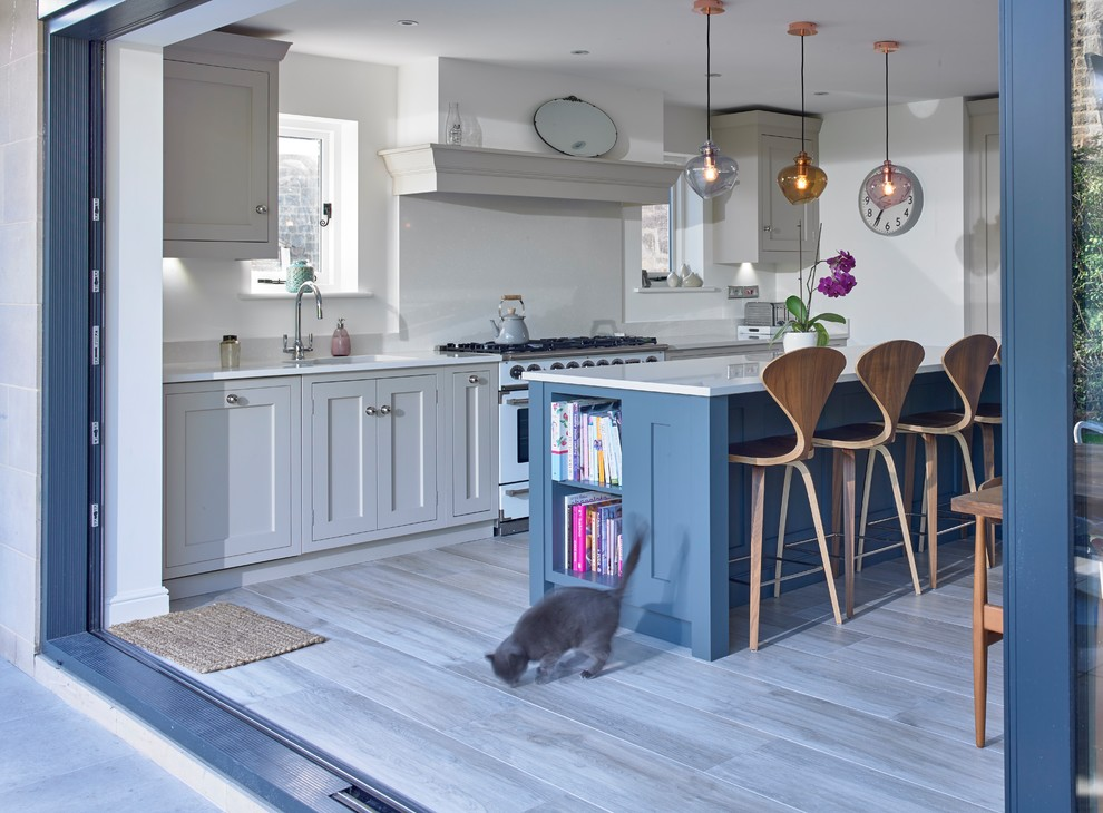 Mid-sized transitional single-wall porcelain tile and gray floor eat-in kitchen photo in Other with quartzite countertops, an island, an undermount sink, shaker cabinets, gray cabinets, white backsplash, stainless steel appliances and white countertops