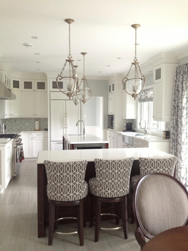 Example of a transitional kitchen design in Montreal