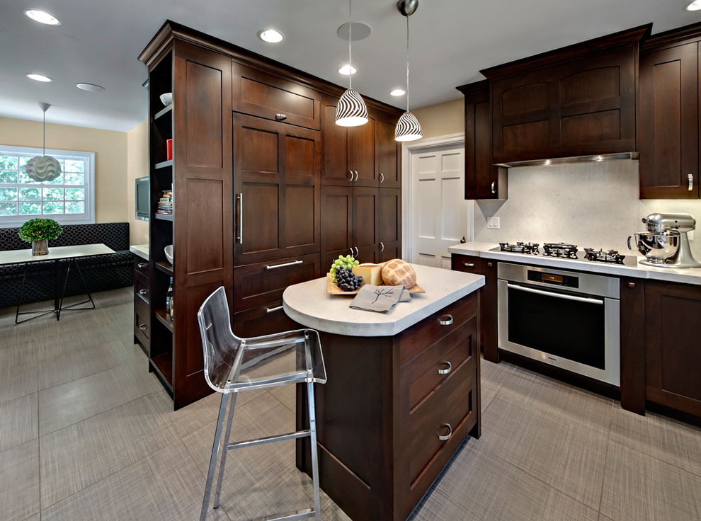 Inspiration for a small contemporary l-shaped enclosed kitchen remodel in Minneapolis with paneled appliances, recessed-panel cabinets, dark wood cabinets, white backsplash and an island