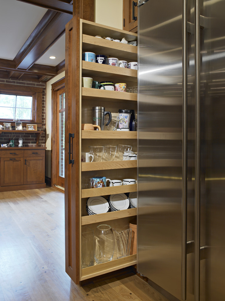 Elegant kitchen photo in Chicago with medium tone wood cabinets and recessed-panel cabinets