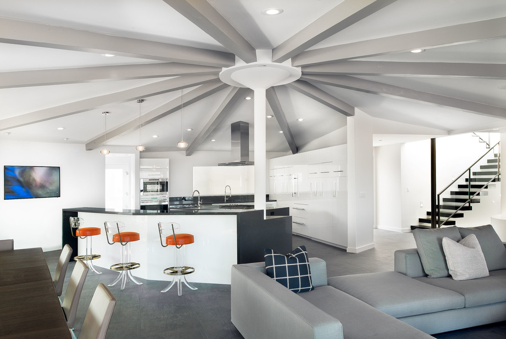 Example of a mid-century modern open concept kitchen design in Los Angeles with flat-panel cabinets and white cabinets