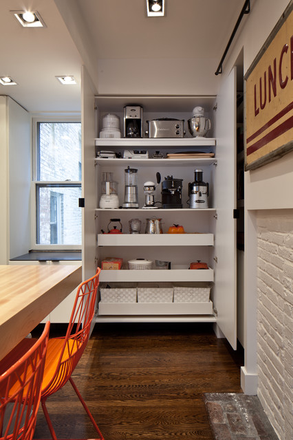 Example of a trendy kitchen design in Boston with wood countertops, flat-panel cabinets, white cabinets and stainless steel appliances
