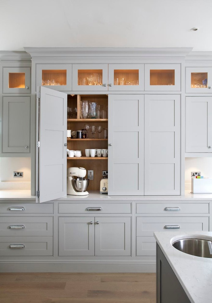 Transitional kitchen photo in Dublin with beaded inset cabinets, gray cabinets, quartz countertops and an undermount sink