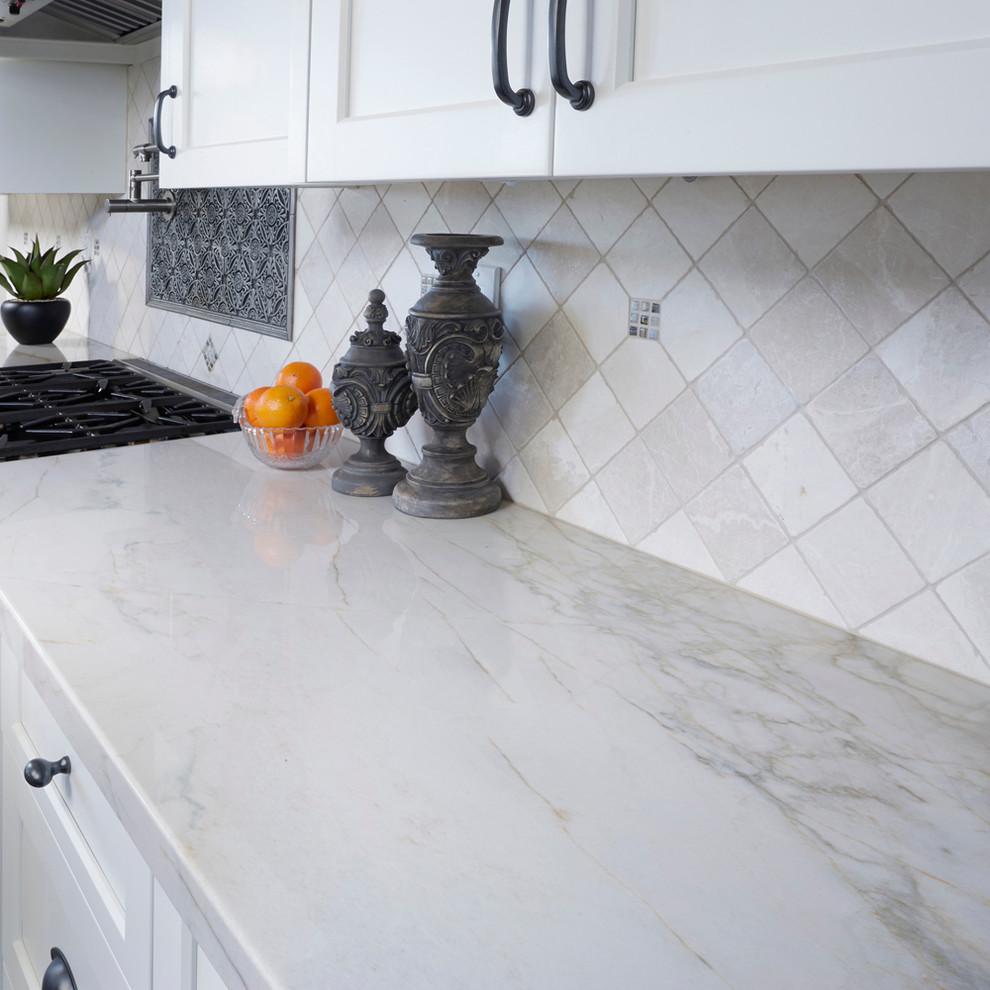 Large kitchen photo in San Diego with marble countertops, stone tile backsplash, white backsplash and white countertops