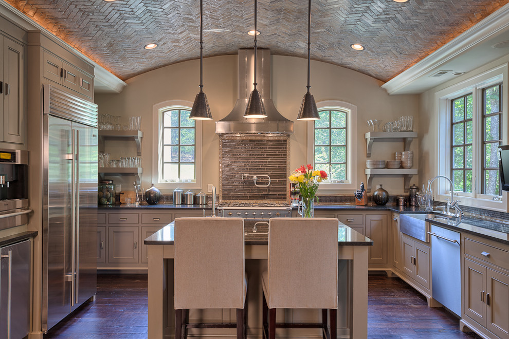Enclosed kitchen - traditional u-shaped enclosed kitchen idea in Other