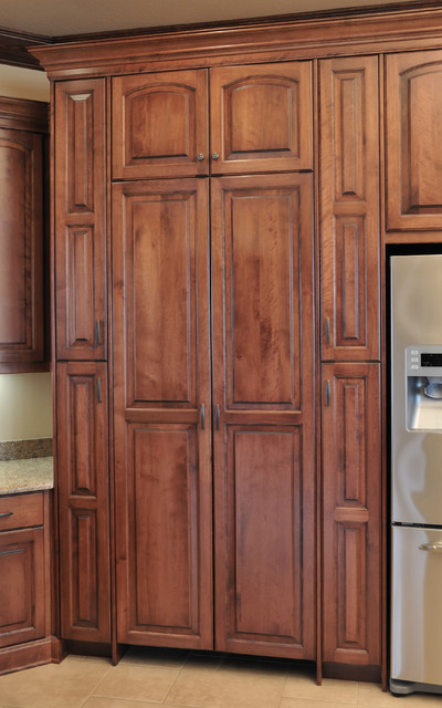 Cabinetry With Cherry Stain Finish